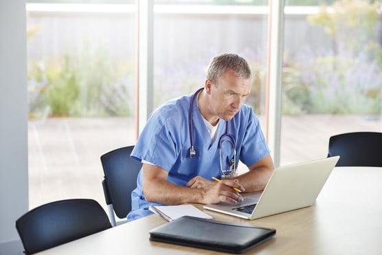 Doctor viewing laptop - blog post image